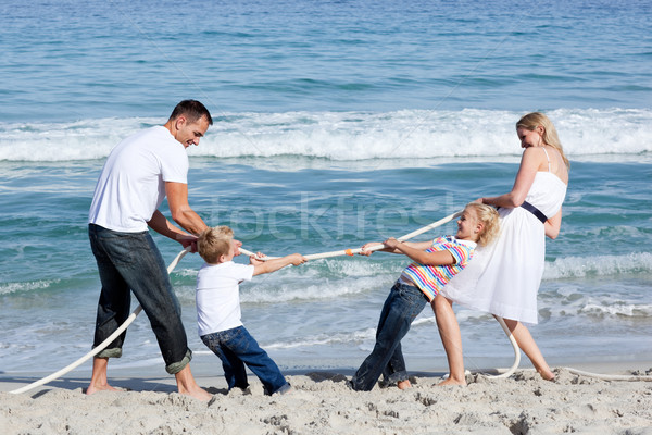 Excited family playing tug of war at the beach Stock photo © wavebreak_media