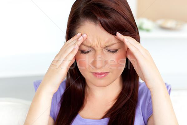 Genç kadın baş ağrısı ev livingroom ağrı güzel Stok fotoğraf © wavebreak_media