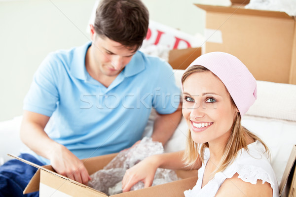 Ambitious young couple unpacking boxes with glasses in their new home Stock photo © wavebreak_media