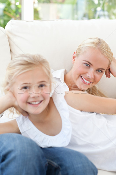 Beautiful woman lying down with her daughter at home Stock photo © wavebreak_media