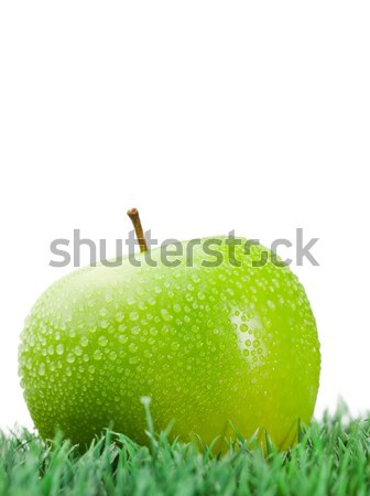 Green wet apple on grass on a white background Stock photo © wavebreak_media