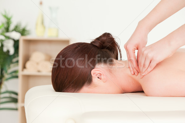 Red-haired woman receiving a back massage Stock photo © wavebreak_media