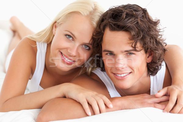Pár ágy hálószoba nő mosoly szeretet Stock fotó © wavebreak_media