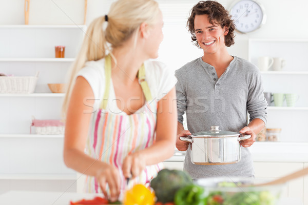 Young couple cooking in their kitchen Stock photo © wavebreak_media