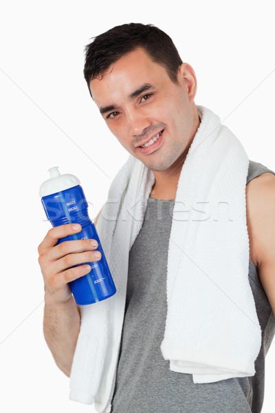 Сток-фото: молодые · мужчины · бутылку · подготовки · белый · спорт