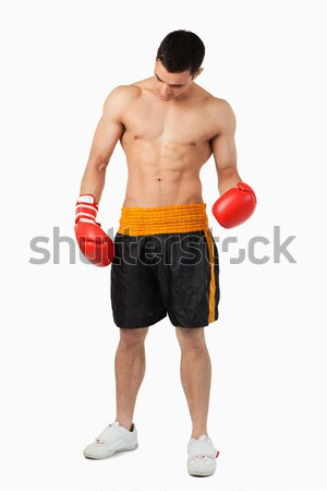 Young ripped boxer against a white background Stock photo © wavebreak_media