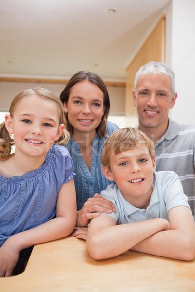 портрет семьи позируют кухне глядя камеры Сток-фото © wavebreak_media