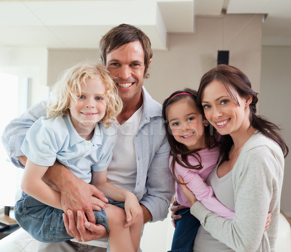 Charming family posing together in a living room Stock photo © wavebreak_media