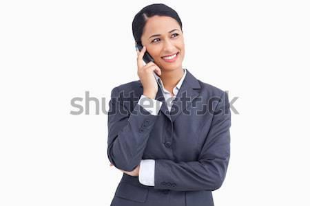 Vendedora teléfono móvil blanco negocios sonrisa Foto stock © wavebreak_media