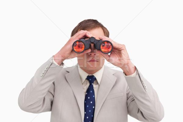 Businessman using binoculars against a white background Stock photo © wavebreak_media