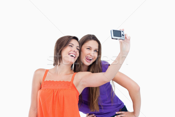 Teenagers posing and photographing themselves Stock photo © wavebreak_media