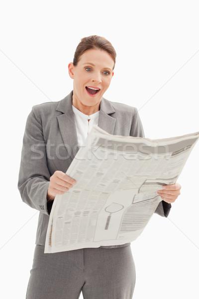 удивленный деловая женщина Постоянный чтение газета бизнеса Сток-фото © wavebreak_media