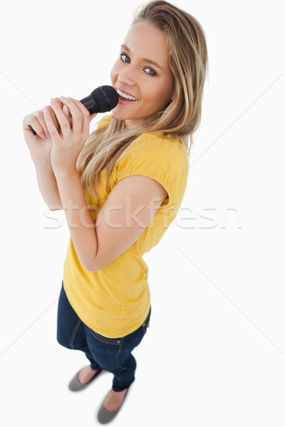 Fisheye blond meisje zingen microfoon Stockfoto © wavebreak_media