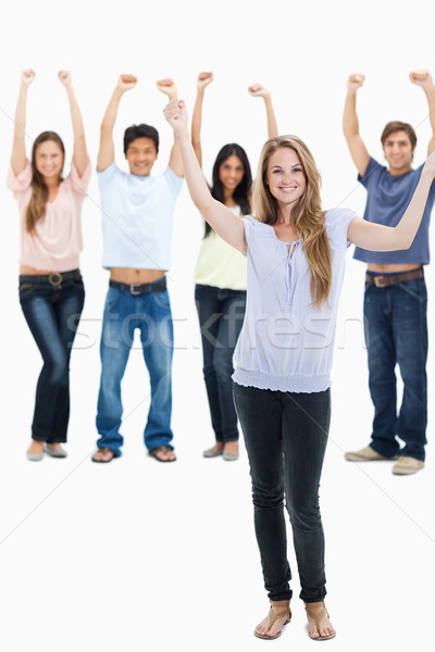 People in jeans with their arms raised against white background Stock photo © wavebreak_media