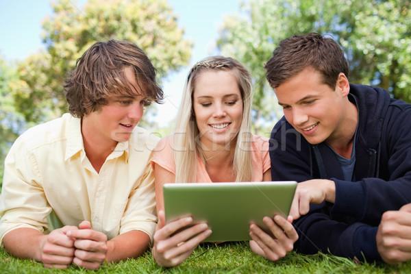 Trois élèves touch parc Homme souriant Photo stock © wavebreak_media
