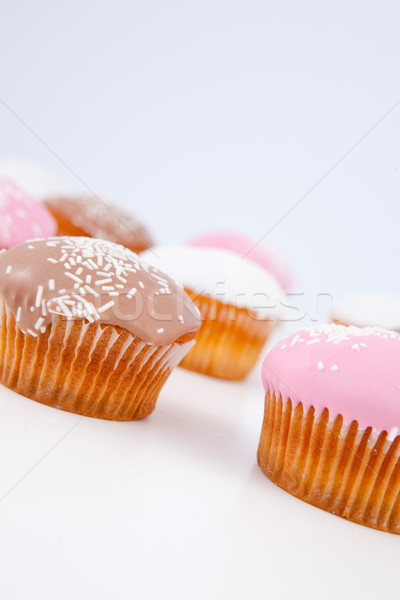 Muffins with icing sugar lined up against a blue background Stock photo © wavebreak_media