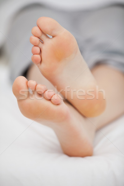 Close-up of the feet of a woman who is lying in a room Stock photo © wavebreak_media