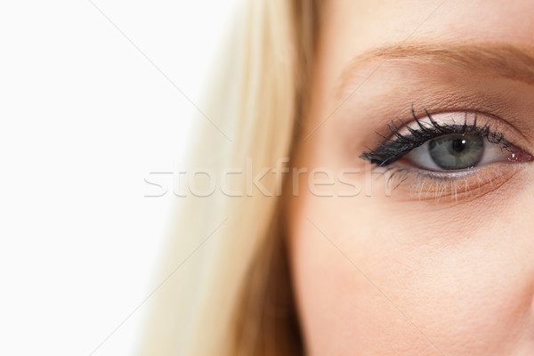 Blonde woman staring at the camera against a white background Stock photo © wavebreak_media