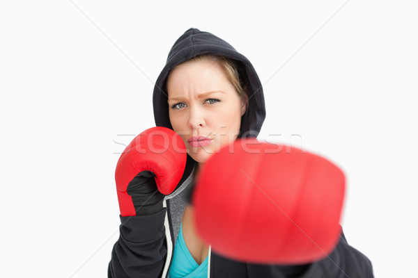 Woman with gloves hitting against white background Stock photo © wavebreak_media