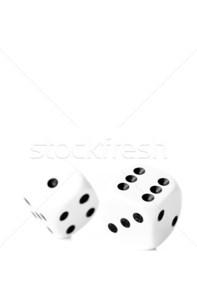 Two black and white dices in motion against a white background Stock photo © wavebreak_media