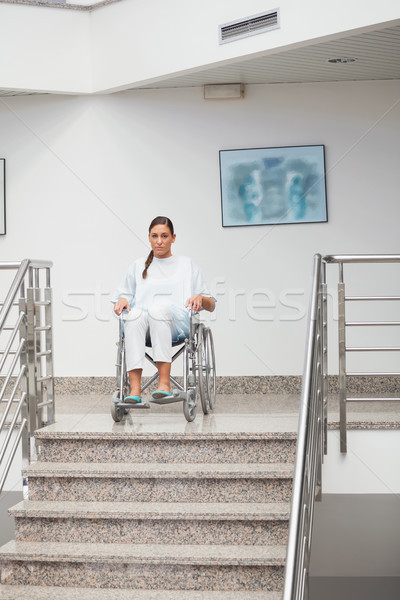 Female patient sitting on a wheelchair in hospital corridor Stock photo © wavebreak_media