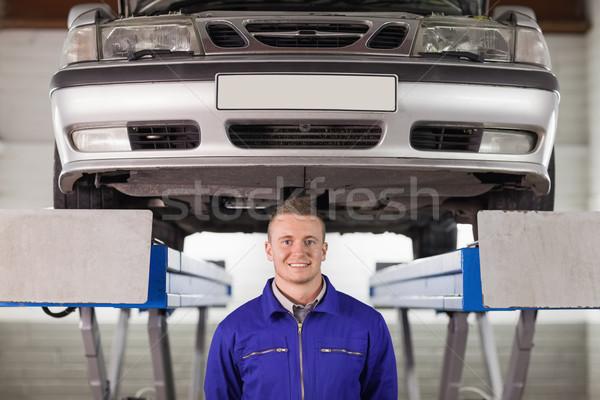 Mecânico abaixo carro garagem homem trabalhador Foto stock © wavebreak_media