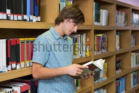 Adam kitaplık kütüphane Stok fotoğraf © wavebreak_media