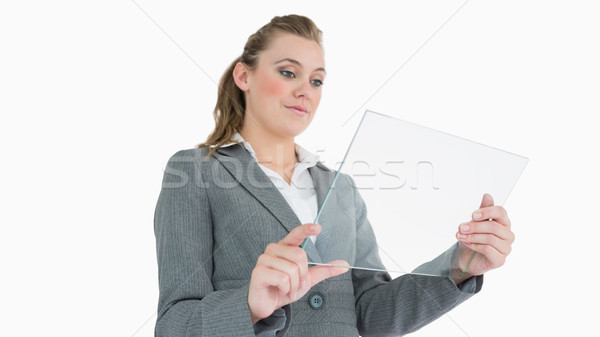 Businesswoman looking at glass pane and smiling Stock photo © wavebreak_media