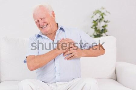 Homem sofrimento coração dor sofá Foto stock © wavebreak_media