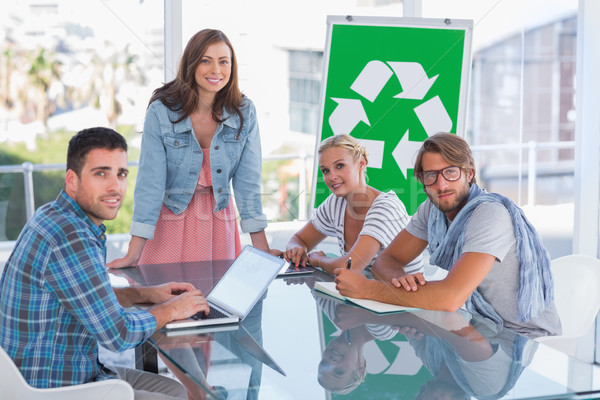 Csapat megbeszélés újrahasznosítás mosolyog kamera fényes Stock fotó © wavebreak_media