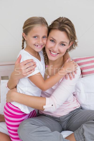 Mother and daughter smiling at camera Stock photo © wavebreak_media