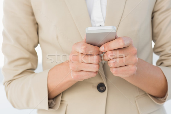 Mid section of a businesswoman text messaging Stock photo © wavebreak_media