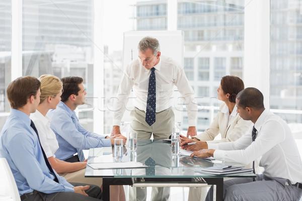 корма бизнесмен глядя вниз сотрудников заседание служба Сток-фото © wavebreak_media