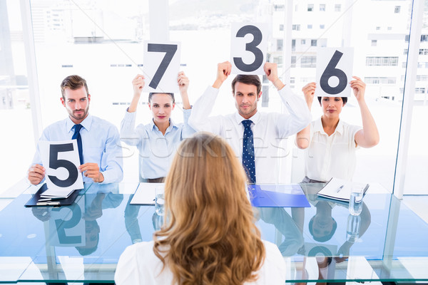 Groupe panneau score signes femme Photo stock © wavebreak_media