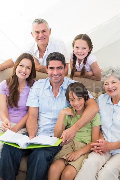 Happy multigeneration family with book Stock photo © wavebreak_media