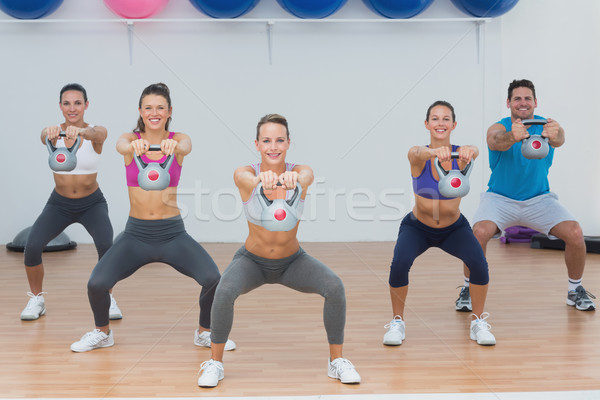 Fitness class exercising with kettlebells in gym Stock photo © wavebreak_media