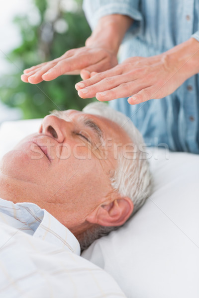 Senior man having Reiki treatment Stock photo © wavebreak_media