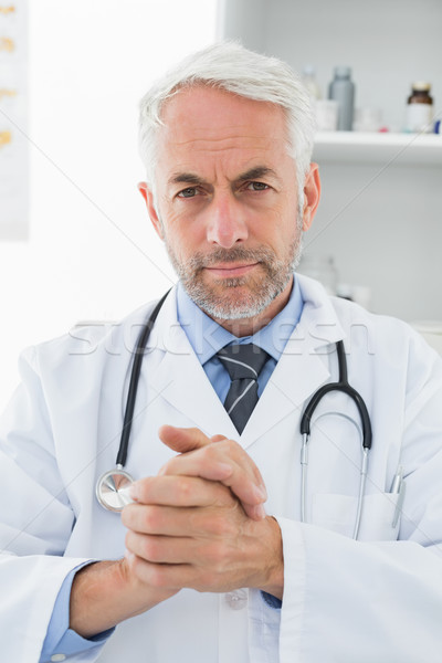 Serious confident male doctor at medical office Stock photo © wavebreak_media