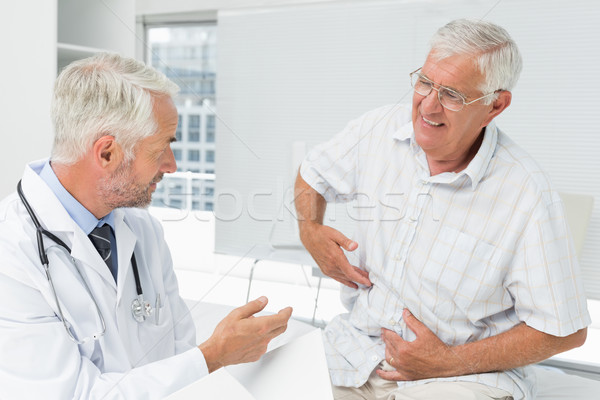 Stock photo: Male senior patient visiting a doctor