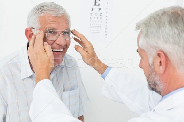 Man wearing glasses after taking vision test at doctor Stock photo © wavebreak_media