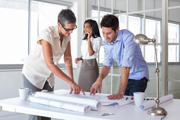 Architects looking at important blueprints Stock photo © wavebreak_media