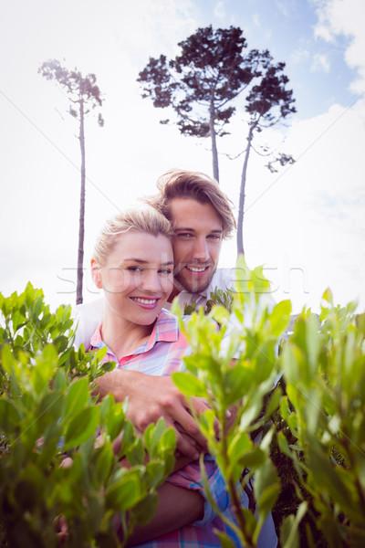 Glimlachend paar buiten Stockfoto © wavebreak_media