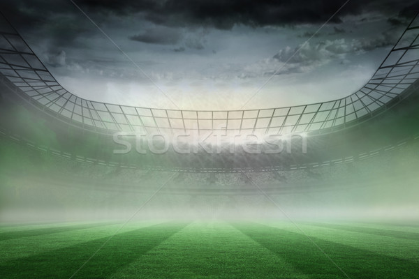 Misty football stadium under spotlights Stock photo © wavebreak_media