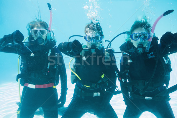 Friends on scuba training submerged in swimming pool showing thu Stock photo © wavebreak_media