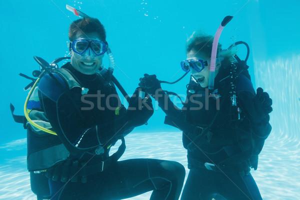 Man huwelijk geschokt vriendin onderwater scuba Stockfoto © wavebreak_media