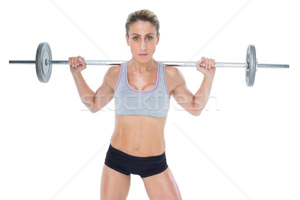 Erős női emel súlyzó mögött fej Stock fotó © wavebreak_media