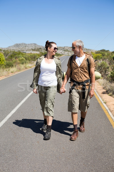 Hitch hiking couple holding hands on the road  Stock photo © wavebreak_media