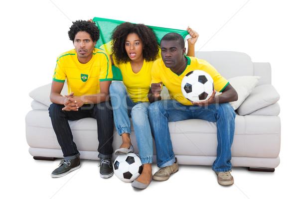 Piłka nożna fanów żółty posiedzenia sofa biały Zdjęcia stock © wavebreak_media