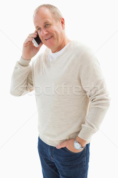 Gelukkig volwassen man telefoon witte jeans glimlachend Stockfoto © wavebreak_media