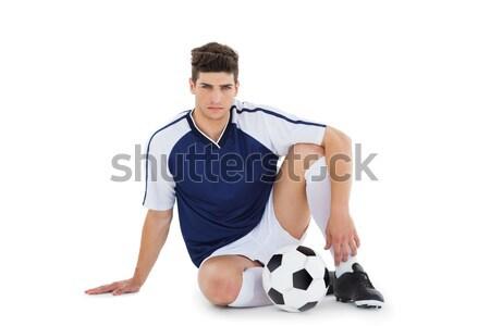 Voetballer vergadering grond bal witte sport Stockfoto © wavebreak_media